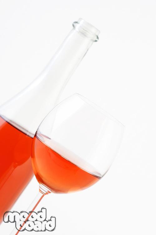 Close-up of rose wine on white background