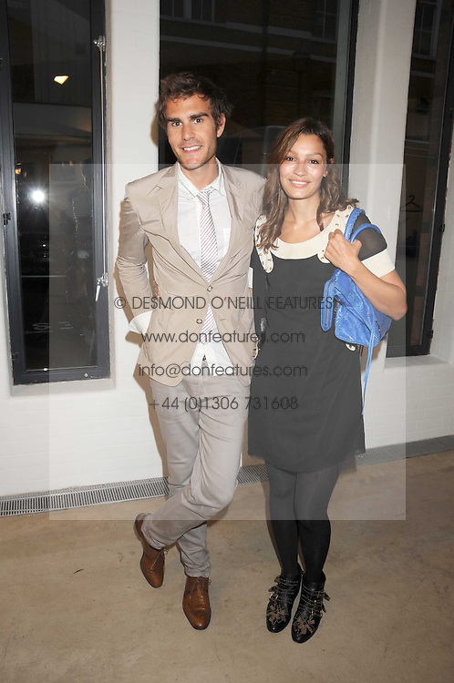 OSCAR HUMPHRIES and SARA PHILIPPIDIS at the Quintessentailly Summer Party at the Phillips de Pury Gallery, 9 Howick Place, London on 9th July 2008.<br />