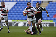 Reading, GREAT BRITAIN, Saracens, Glenn JACKSON, leaves the Exiles defenders, [grounded] Olivier MAGNE, and Jaun LEGUIZAMON,  during the EDF Energy Cup, rugby match, London Irish vs Saracens at the Madejski  Stadium, ENGLAND, 30/09/2006. [Photo, Peter Spurrier/Intersport-images]..