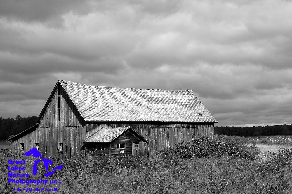 This old barn in Door County, Wisconsin, stands its ground against the threatening skies overhead.<br /> <br /> I have always considered storms to be an important aspect of my photographic mission. Black and white images of storms magnify their visual impact.<br /> <br /> As is the case with most of the aging agricultural buildings that I photograph, I can't help but to wonder about the history that this barn has been a part of.