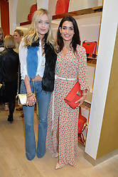 Left to right, LAURA WHITMORE and TONIA SOTIROPOULOU at the launch the Folli Follie Flagship store at 493 Oxford Street, London on 28th May 2015.
