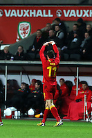 Pictured: Gareth Bale of Wales celebrating his opening goal with his trademark heart gesture. Wednesday 06 February 2013..Re: Vauxhall International Friendly, Wales v Austria at the Liberty Stadium, Swansea, south Wales.