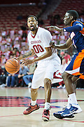 FAYETTEVILLE, AR - DECEMBER 19:  Rashad Madden #00 of the Arkansas Razorbacks looks to make a pass against the UT Martin Skyhawks at Bud Walton Arena on December 19, 2013 in Fayetteville, Arkansas.  The Razorbacks defeated the Skyhawks 102-56.  (Photo by Wesley Hitt/Getty Images) *** Local Caption *** Rashad Madden