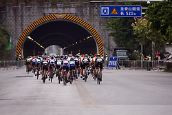 The peloton head into a tunnel at GREE Tour of Guangxi Women's WorldTour 2019 a 145.8 km road race in Guilin, China on October 22, 2019. Photo by Sean Robinson/velofocus.com