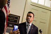 Representative Michael G. Grimm(R-NY) of Staten Island speaks with reporters on his indictment charges outside his capitol office in the Cannon House Office Building in Washington DC on April 29, 2014. Photo by Kris Connor