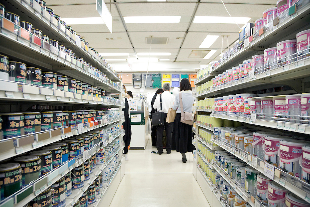 aisle with various paint cans in a large department store in Tokyo