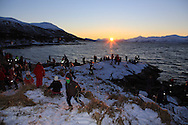 Children gather at Telegrafbukta at the south end of Tromsoya island on January 21st watching return of the sun after its two-month absence; Tromso, Norway.