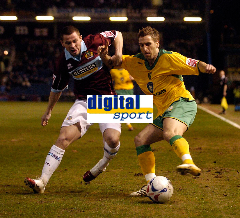 Photo: Jed Wee.<br /> Burnley v Norwich City. Coca Cola Championship. 24/03/2006.<br /> <br /> Norwich's Darren Huckerby (R) tries to take on Burnley's Phil Bardsley, making his first appearance for Burnley since joining them on loan from Manchester United.