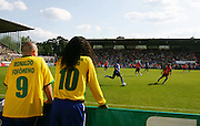 Ronaldo and Ronaldinho lookalikes look on during Brazil's public training session