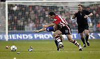 Photo. Aidan Ellis.<br /> Southampton v Everton.<br /> FA Barclaycard Premiership.<br /> 21/02/2004.<br /> Southampton's Paul Telfer and Everton's Thomas Gravesen