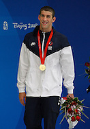 BEIJING, CHINA:  USA's swimmer Michael Phelps smiles after he  won his third goal medal in swimming today by  winning the 200-meter freestyle and breaking his own world record with a time of 1 minute, 42.96 seconds.  ©2008 Johnny Crawford