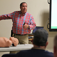 Eddie Hawkins shows local law enforcement officers the new 4mg dose of narcan they are being trained on how to use in case they arrive at scene involving a drug overdose.