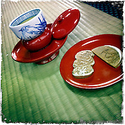 Photo shows the unique lacquerware saucers used to serve tea at Dogo Onsen, thought to be Japan's oldest spa in Matsuyama City, Ehime Prefecture, Japan on 20 Feb. 2013.  Tea and snacks are served post-bathing on one of the spa's 4 courses. The white heron seen on the tea cup is a recurring motif at the spa, dating back to a legend that says a lame heron was cured by the waters here,  triggering the establishment of the first community here about 3,000 years. Photographer: Robert Gilhooly