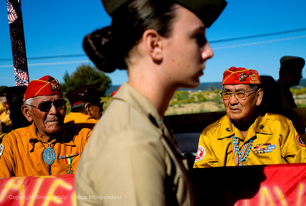 081408      Brian Leddy.Navajo Code Talkers Bahe Ketchum and Alfred Peaches sit on their parade float as Cynthia Wolanski if Pittsburgh, Pa. walks along side them. The Navajo Nation celebrated the Code Talkers achievements with an official tribal holiday on Thursday.