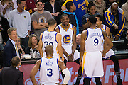 The Golden State Warriors laugh as they wait for officials to review a play against the Cleveland Cavaliers at Oracle Arena in Oakland, Calif., on January 16, 2017. (Stan Olszewski/Special to S.F. Examiner)