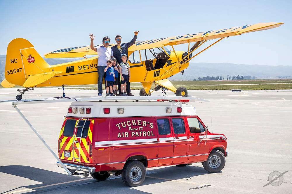Erik Tucker lands his Piper J3 Cub atop a moving van for the 2018 airshow season at the Salinas Municipal Airport