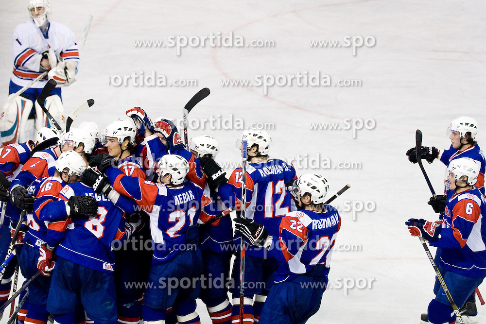 Slovenian players celebrating Ziga Jeglic's overtime winning goal at IIHF Ice-hockey World Championships Division I Group B match between National teams of Slovenia and Great Britain, on April 20, 2010, in Tivoli hall, Ljubljana, Slovenia. (Photo by Matic Klansek Velej / Sportida)