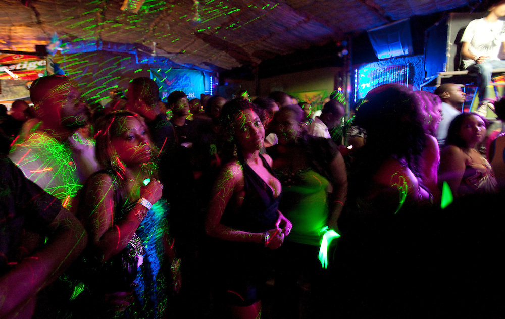 People dancing in a club named Fast Food in Petion-Ville, Haiti on July 24, 2010.<br /> Six month after a catastrophic earthquake measuring 7.3 on the Richter scale hit Haiti on January 13, 2010, killing an estimated 230,000 people, injuring an estimated 300,000 and making homeless an estimated 1,000,000.