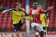 Alex Gilbey of Colchester United does battle with Mathieu Manset of Walsall during the Sky Bet League 1 match between Walsall and Colchester United at the Banks's Stadium, Walsall<br /> Picture by Richard Blaxall/Focus Images Ltd +44 7853 364624<br /> 06/09/2014