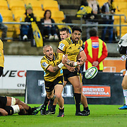 TJ Perenara passes the ball from the scrum during the super rugby union  game between Hurricanes  and Highlanders, played at Westpac Stadium, Wellington, New Zealand on 24 March 2018.  Hurricanes won 29-12.