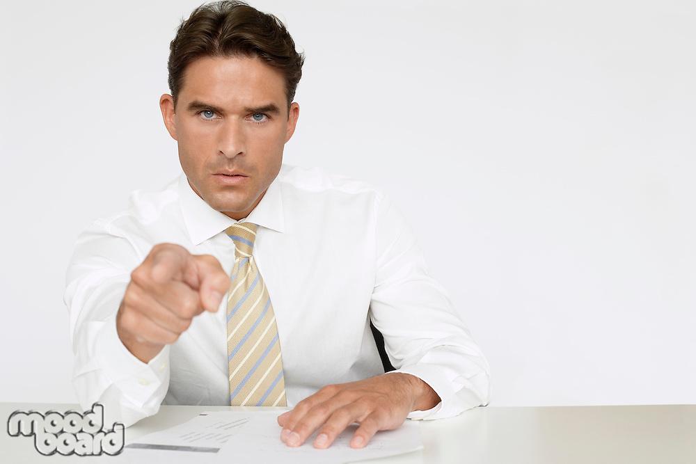 Businessman Pointing Finger