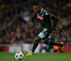 LONDON, ENGLAND - Oct 01: Napoli's defender Camilo Zuniga from Columbia runs with the ball during the UEFA Champions League match between Arsenal from England and Napoli from Italy played at The Emirates Stadium, on October 01, 2013 in London, England. (Photo by Mitchell Gunn/ESPA)