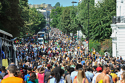 © Licensed to London News Pictures. 27/08/2017. London, UK. Crowds in Ladbroke Grove are seen on Family Day at the Notting Hill Carnival.  Over one million revellers are expected to attend Europe's biggest street party which takes place over the Bank Holiday Weekend. Photo credit : Stephen Chung/LNP