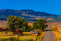 A ranch along the road, near Yampa, Routt County, Colorado USA in the Flat Tops Trail Scenic Byway (with the Flat Tops Mountain Range in the background.)