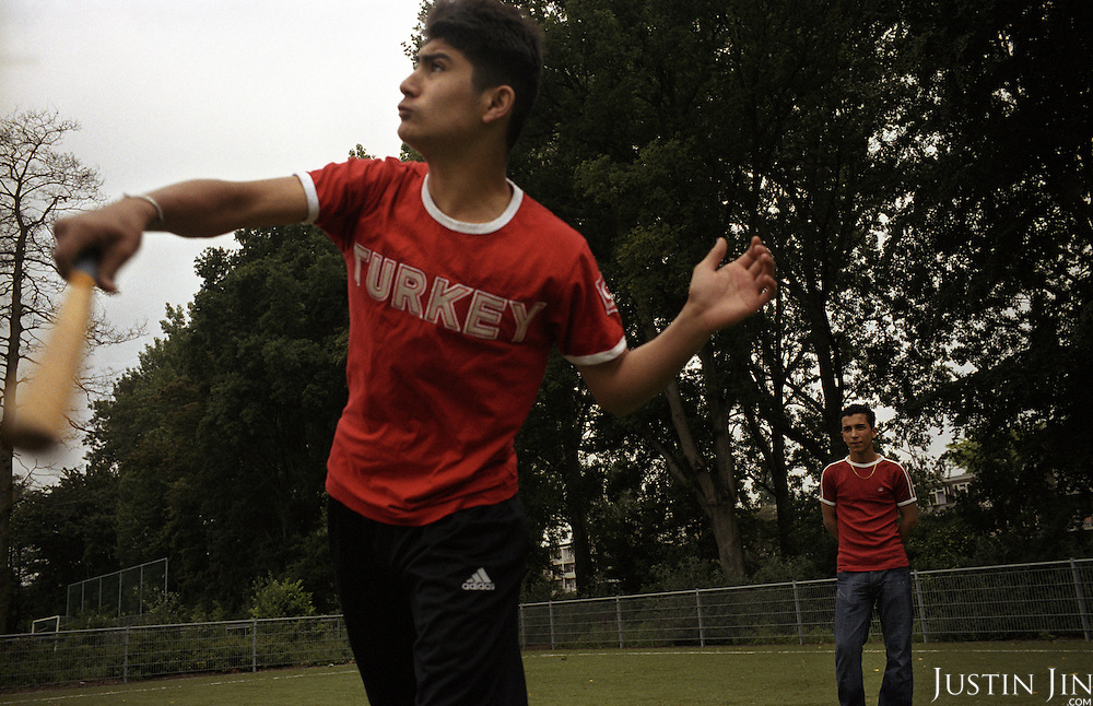 Dutch-Turkish teenager Hakan Dinc (R) and his school mate play softball during a sport lesson at a the De Meer pre-vocational school in Amsterdam..The school is pre-dominantly made up of kids of Turkish and Moroccan backgrounds.  .Dinc, 16, was born in the Netherlands. His grandparents from his father?s side came from Turkey in 1971, and his mother came in 1987. Dinc feels more Turkish than Dutch, most of his friends are Turkish and he wants to marry a Turkish girl. During his time off he works in his uncle?s grocery store. Later, he wants to have his own shop. Dinc is following a Commerce course at a vocational school in Amsterdam. .Dinc likes music, pool and chilling out. He has a fourteen-year-old sister and a brother aged ten months. .Picture shot in Amsterdam in 2004 by Justin Jin. .