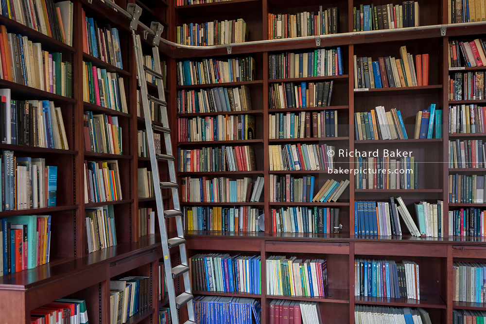 Books line the shelves in the Lee Library of the British Academy, on 17th September 2017, at 10-12 Carlton House Terrace, in London, England. The British Academy was proposed in 1899 for the promotion of Historical, Philosophical and Philological studies library is now used for study and research (and even for licensed marriage ceremonies). It moved to 10-12 Carlton House Terrace in 1998 but the address was built during the late 1820s and early 1830s on land previously occupied by Carlton House, the residence of the Prince Regent, who became George IV. The neoclassical terrace was conceived by architect John Nash.