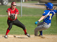 Gilford's Mattice slides into third ahead of Laconia's Erica Marchione during NHIAA Division III Softball Wednesday afternoon.  (Karen Bobotas/for the Laconia Daily Sun)