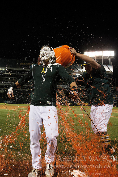 OAKLAND, CA - JULY 19:  Billy Butler #16 of the Oakland Athletics pours Gatorade on Josh Reddick #22 after the game against the Houston Astros at the Oakland Coliseum on July 19, 2016 in Oakland, California. The Oakland Athletics defeated the Houston Astros 4-3 in 10 innings.  (Photo by Jason O. Watson/Getty Images) *** Local Caption *** Billy Butler; Josh Reddick