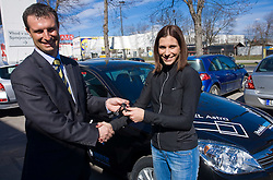 General Manager Tomaz Jeran and Slovenian triple jumper Marija Sestak sponsored with a car Opel Astra by Avtohisa Moste, Ljubljana, Slovenia. (Photo by Vid Ponikvar / Sportida)
