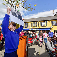 4 year old Ciara Bertozzifrom Junior Infants and Summercove National School pictured holding a portrait of Thomas Clarke at a 1916 commemoration by students from local schools in the Kinsale area and organised by the Kinsale Historical Society.<br /> Picture. John Allen