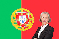 Portrait of senior businesswoman with pride over Portuguese flag