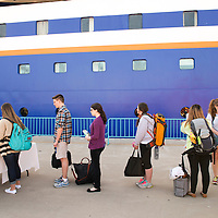 Students completing the check-in process to board the MV Explorer on Embarkation day for the Semester at Sea Spring 2014 Voyage, January 10th 2014, in Ensenada, Mexico.