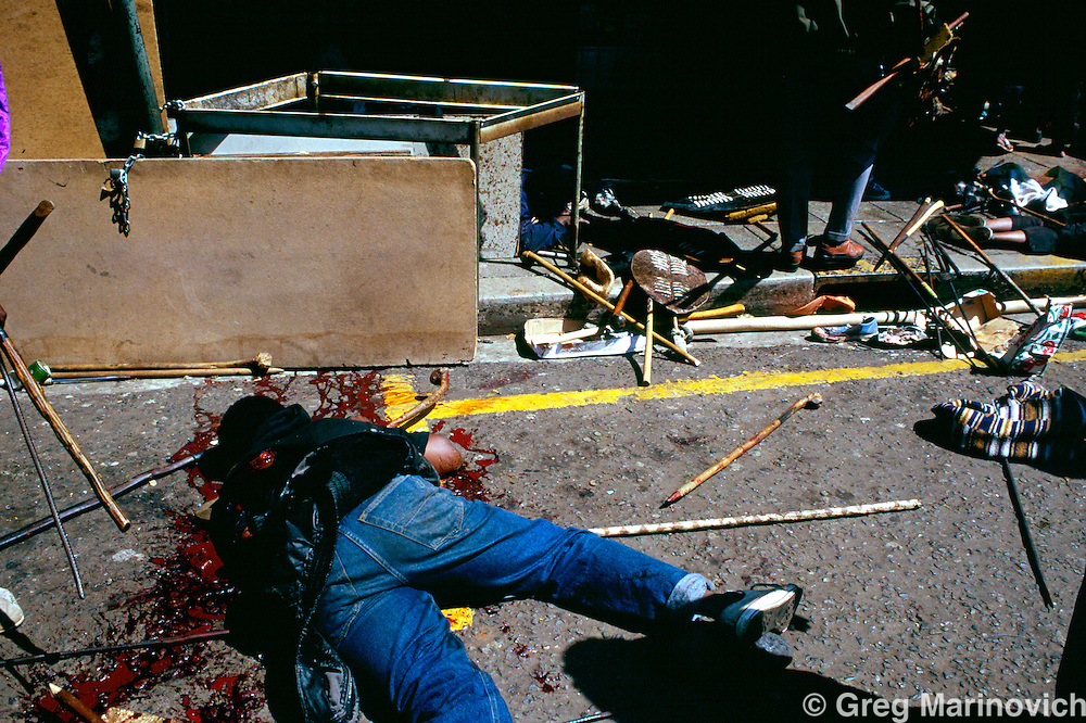 Johannesburg, South Africa, 1994. The dead lie in the street after African National Congress guards opened fire on Inkatha Freedom Party marchers when they approached the ANC headquarters of Shellhouse, Johannesburg 1994. Many IFP supporters killed and wounded. Others were shot from the rooftops by persons unknown at the nearby Library Gardens. Johannesburg, South Africa