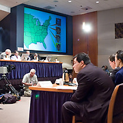 "Commission staffers present Staff Statement No. 16, ""Outline of the 9/11 Plot."" On the screen is a map showing the flight paths of the hijacked planes. The 9/11 Commission's 12th public hearing on ""The 9/11 Plot"" and ""National Crisis Management"" was held June 16-17, 2004, in Washington, DC."