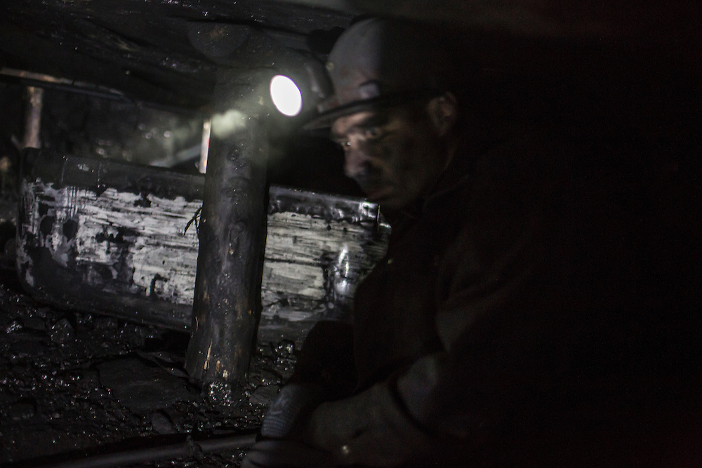 SNEZHNE, UKRAINE - JANUARY 25, 2015: Sergei, who provided only his first name out of concern for the fact that such mines were illegal until recently, digs coal at the bottom of a small private coal mine in Snezhne, Ukraine. The mine produces approximately 15 tons of coal per day with a crew of four men. CREDIT: Brendan Hoffman for The New York Times