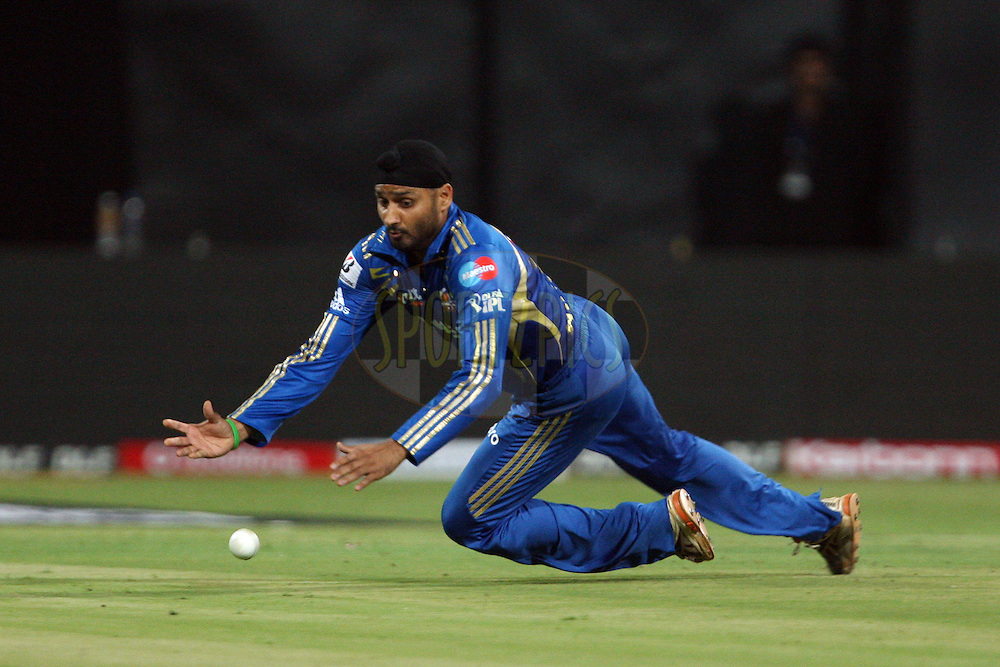 Harbhajan Singh fields off his own bowling during the IPL 2012 Season 5 eliminator match between The Mumbai Indians and The Chennai Superkings held at the M. Chinnaswamy Stadium, Bengaluru on the 23rd May 2012..Photo by Jacques Rossouw/IPL/SPORTZPICS