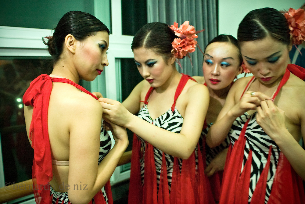 Chinese dancers gets ready to perform during an international salsa dance competition in Beijing, China