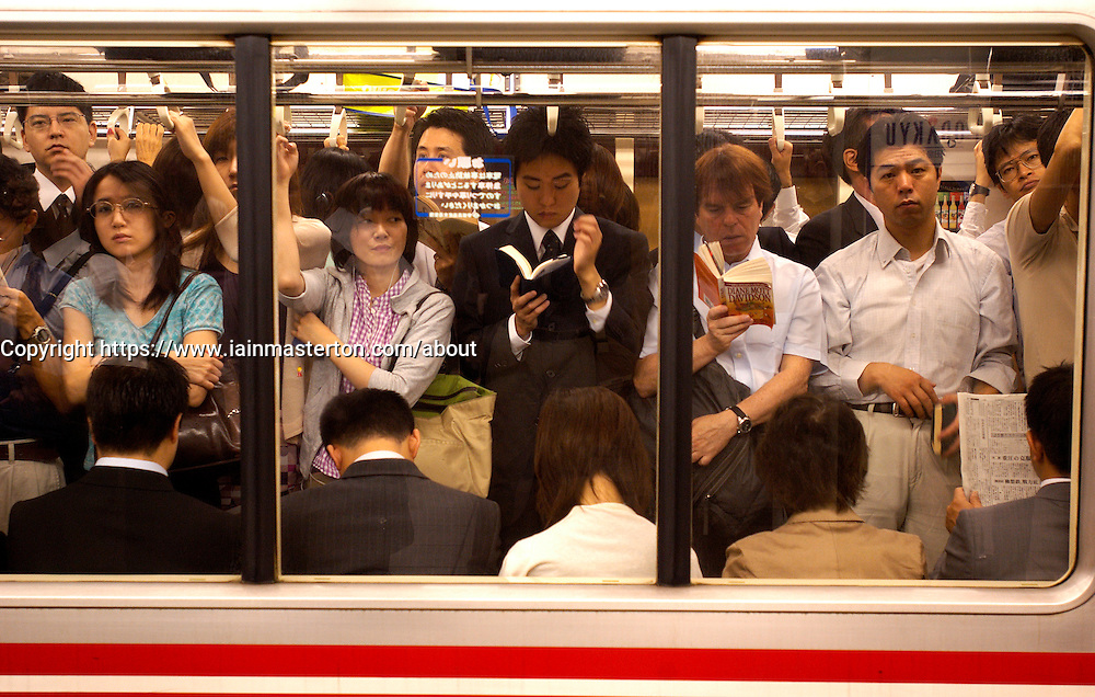Busy subway carriage on the Tokyo metro
