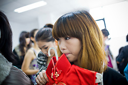 """A participant of """"Miss. International"""" beauty contest prepares for the show in Beijing, China, Nov. 7, 2009."""
