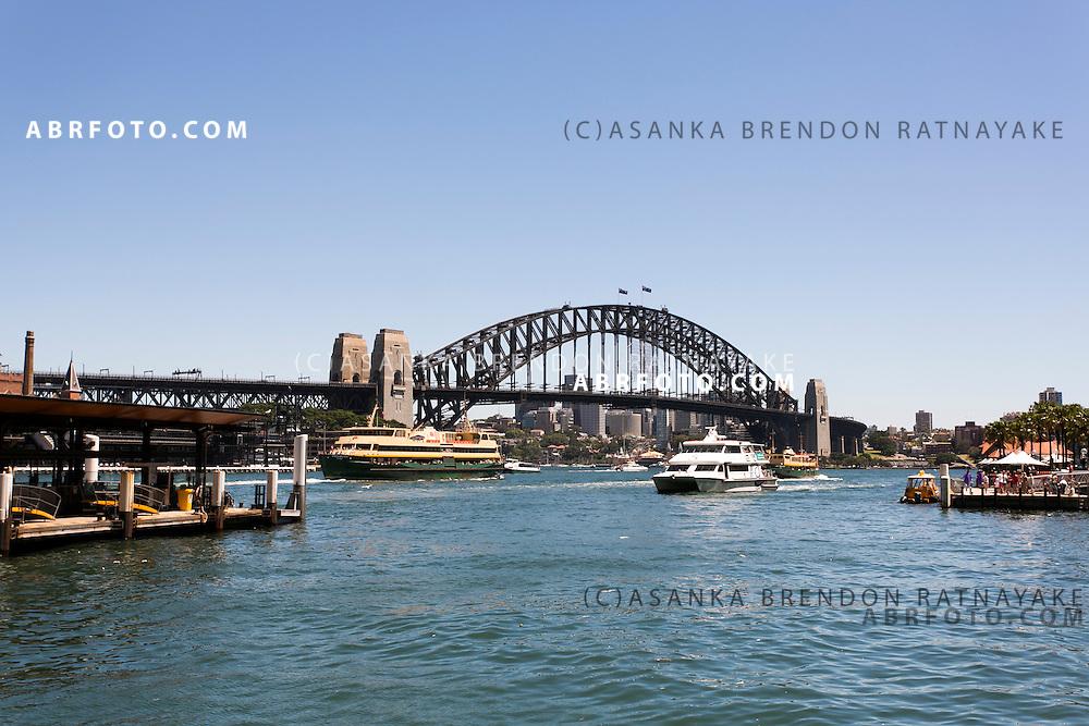 Ferry crossing Sydney Harbour past the Sydney Harbour Bridge