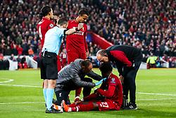 Divock Origi of Liverpool recieves treatment for an injury - Mandatory by-line: Robbie Stephenson/JMP - 07/05/2019 - FOOTBALL - Anfield - Liverpool, England - Liverpool v Barcelona - UEFA Champions League Semi-Final 2nd Leg