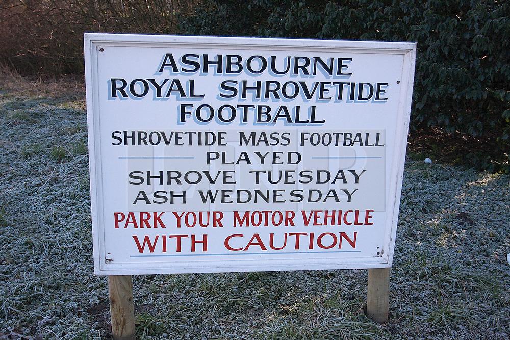 "© under license to London News Pictures. 8/3/11. A sign warning motorists about the game. The Derbyshire town of Ashbourne is besieged by hoards of people as the traditional game of Shrovetide football is played out across the town. Consisting of two teams the ""Upards"" and the ""Downards""; with goal posts two miles apart. Local history has it that the game has been played since the 12th Century. Pictured: WHSmith frontage boarded up. Picture credit should read Sam Spickett/LNP"