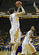 January 12 2010: Iowa Hawkeyes forward Zach McCabe (15) puts up a shot during the first half of an NCAA college basketball game at Carver-Hawkeye Arena in Iowa City, Iowa on January 12, 2010. Northwestern defeated Iowa 90-71.
