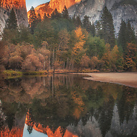 Half Dome at sunset reflected in the Merced River, Yosemite National Park, California.