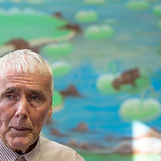 MANASSAS, VA - NOV21:  George Moseley in front of a mural he painted at Birmingham Green, an elder care residence in Manassas, VA, November 21, 2014. With the U.S. population aging and Alzheimer's more widespread, science is looking for ways to slow or delay the onset of dementia in aging Americans. Among the approaches is trying to determine whether art, music and dance or movement can also alleviate the problems attendant with dementia. The federal government is funding a study at Birmingham Green with George Mason University to see whether there is a scientific basis to believe that art is actually medically beneficial. (Photo by Evelyn Hockstein/For The Washington Post)