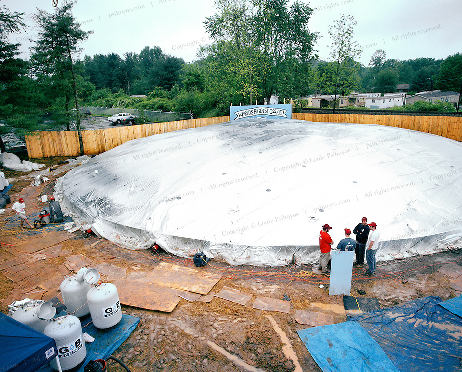 The world's largest cookie oven was created to make the world's largest cookie.  A mylar cover over the cookie dough and 20 propane space heaters cooked the dough to 300 degrees for several hours.